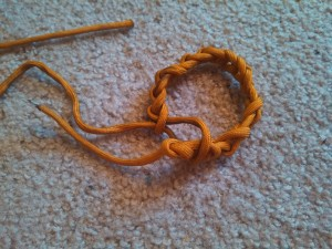 Pass the last loop over the slipknots knot