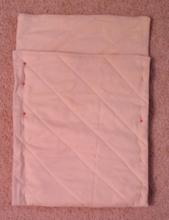 The quilted rectangle folded into bag shape.