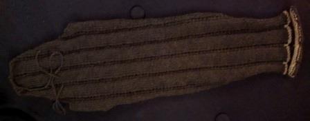 A sleeve as knit.