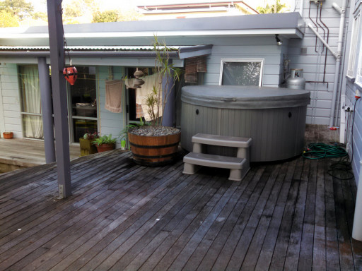 There is a deck with a little hot tub. This will be nice through the winter.