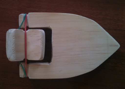 A test fit of the paddlewheel before gluing the deck on. The  paddle had to be sanded down a couple of times to fit well.