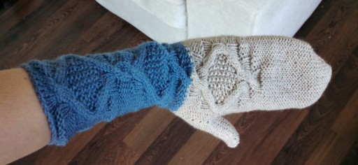 The finished mittens. I'm glad I went with two colors; it makes it look a lot more finished.