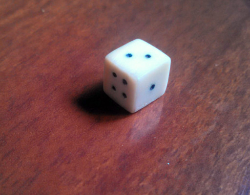 This is a dice, and it actually rolls true. It also is small and historical looking.