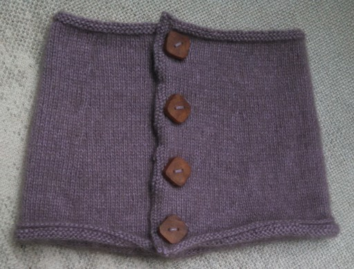 The cowl buttoned up.