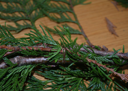 Brass wrapped cedar branches.