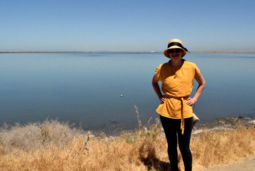Jasmine in the traditional Alviso clothing, fancy hat and normal city attire.