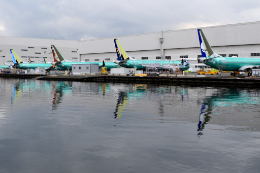 Boeing lines up all the 737's like ducks in a row by the water. The awesome turquoise color is the coating before paining.